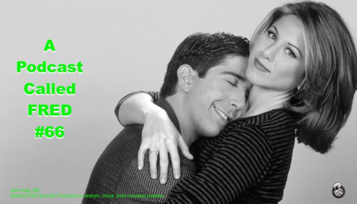 Ross (David Schwimmer) leans into Rachel (Jennifer Aniston), who has her arm around him.